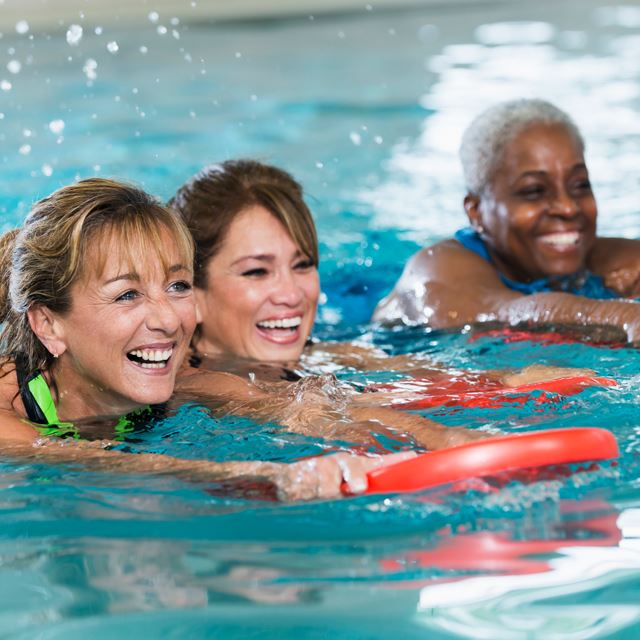 Women smiling in the pool