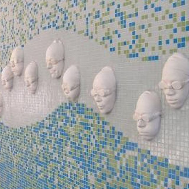 Wall art of swimmers' faces