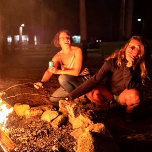 Women by a campfire