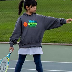 Girl practicing tennis