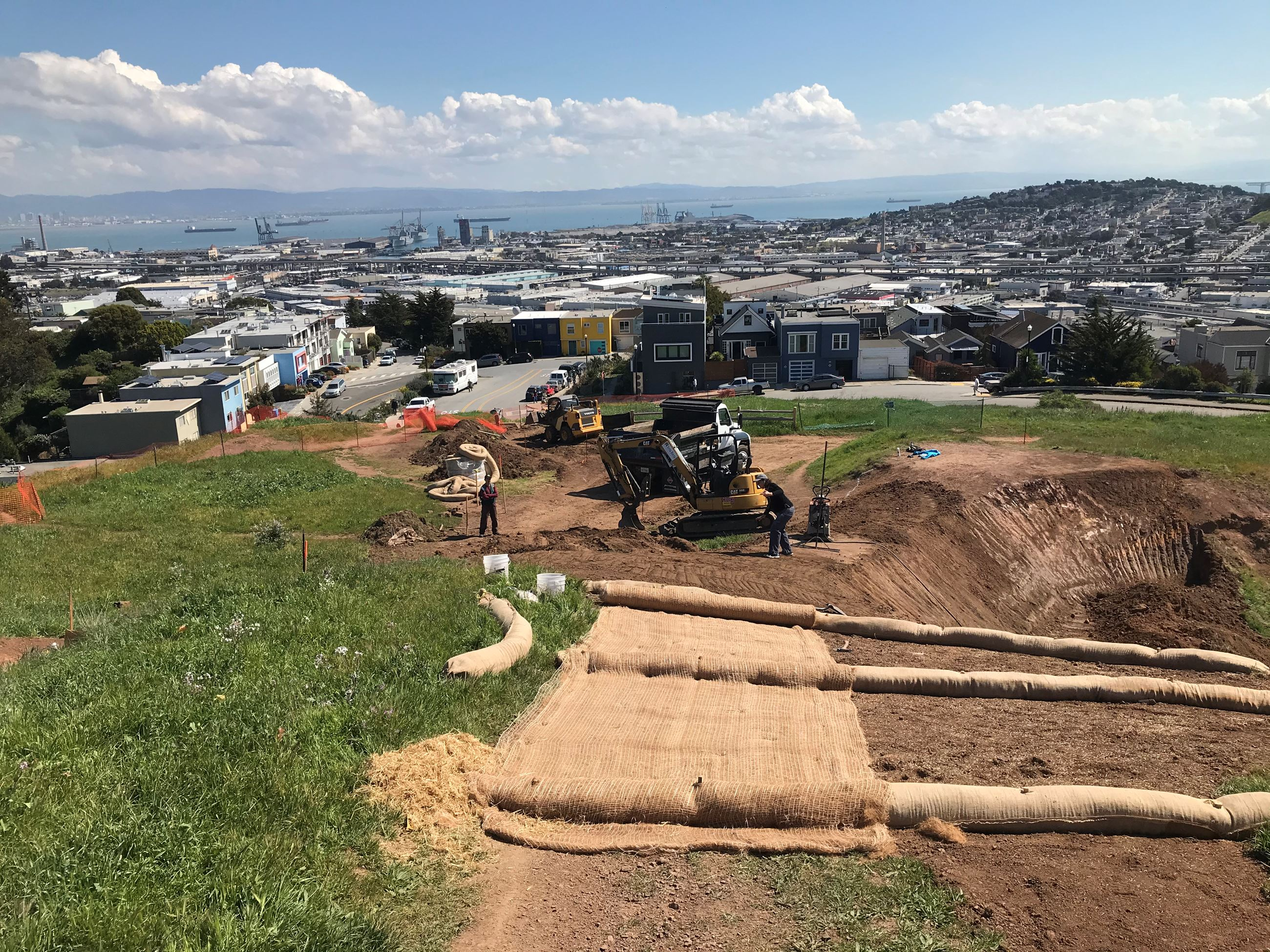 View of Bernal Heights Trail construction showing erosion control measures in the foreground and con