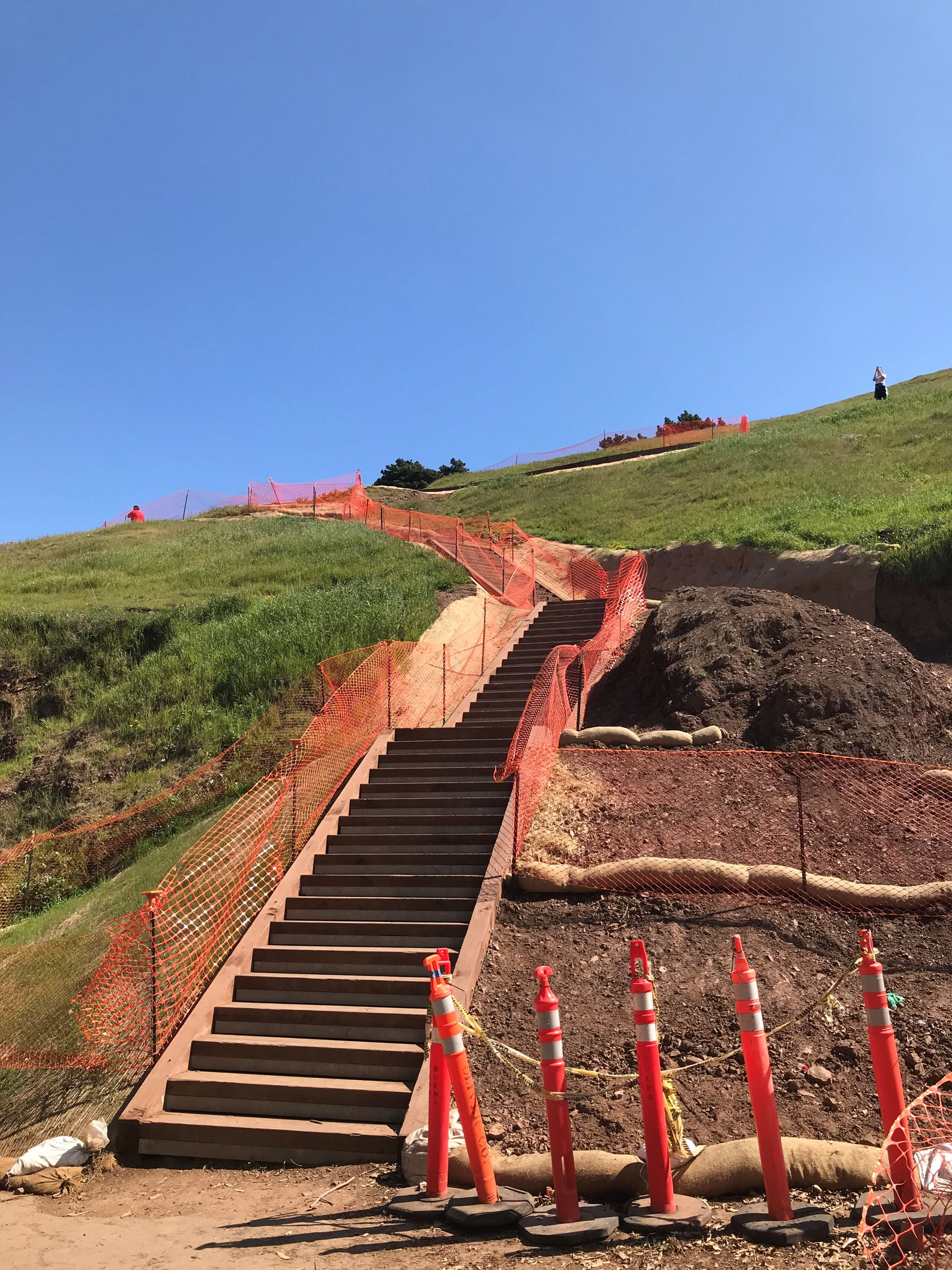 Bernal Heights trial under construction showing box steps with orange construction fencing on either
