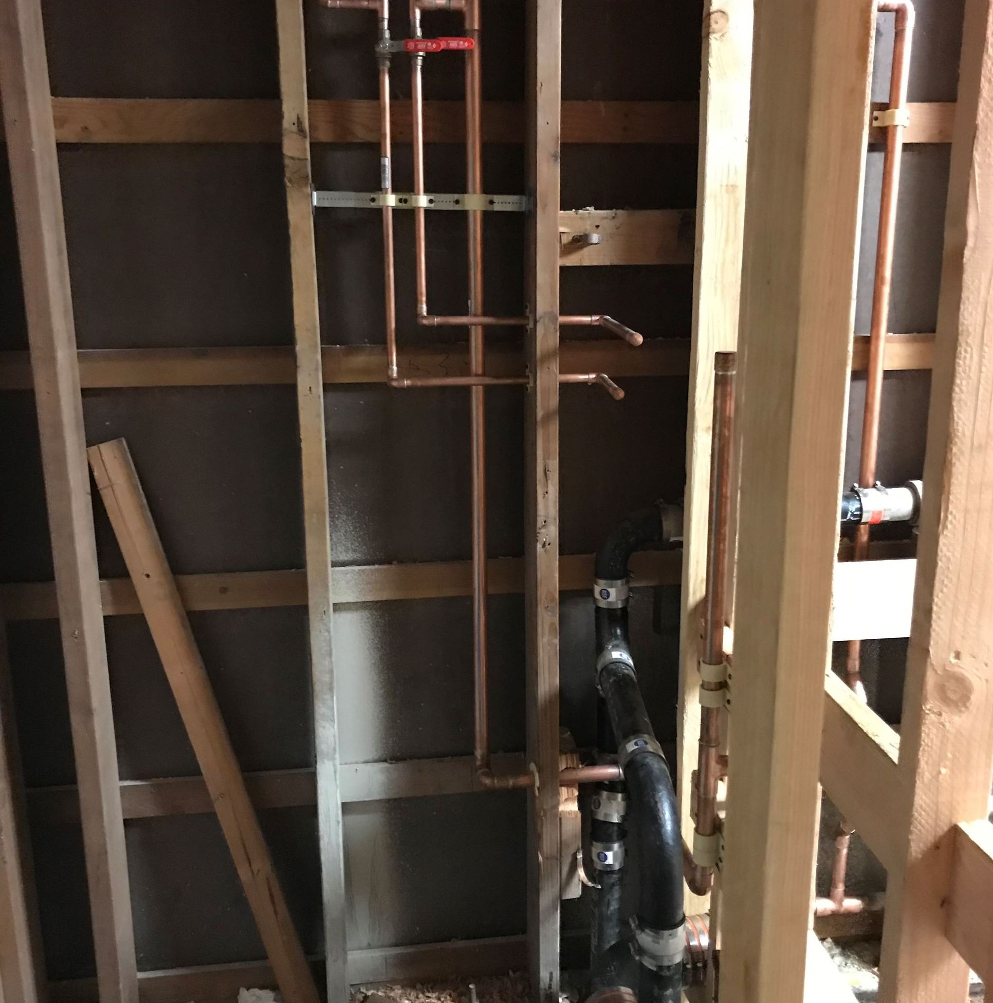 Image shows the South Wall of the custodial closet in construction, this photo is showing the mop si