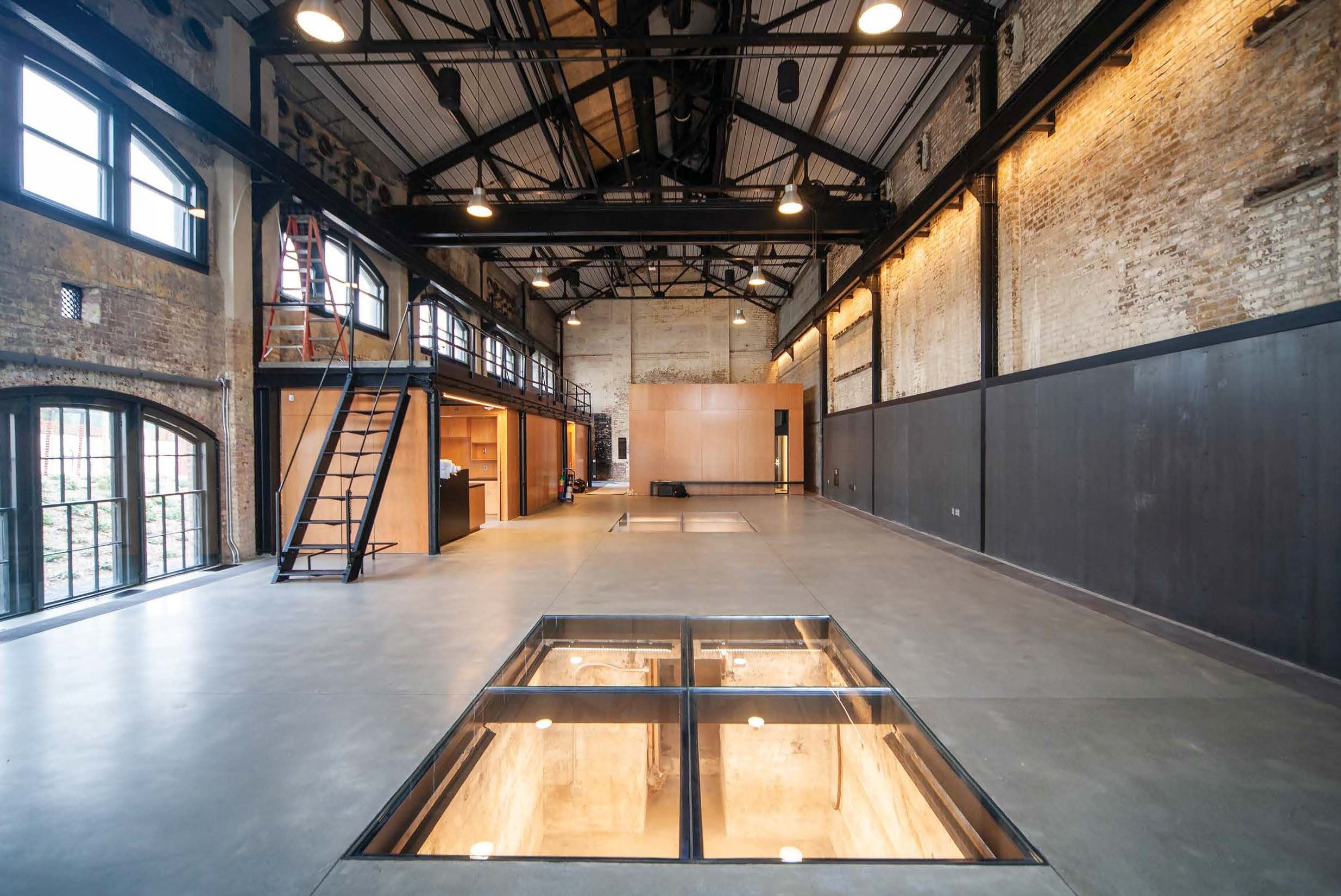 Image shows the Geneva Car Barn Interior Looking north from South wall Kitchen and Office. The ceili