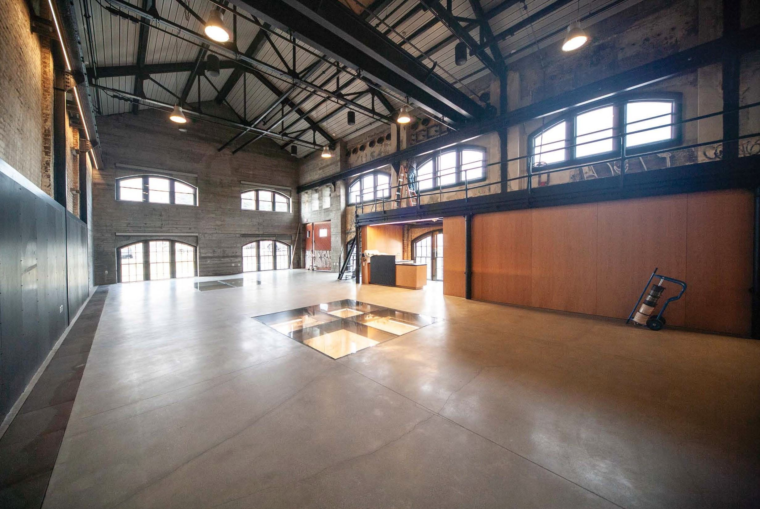 Image shows Geneva Car Barn Interior Looking South West from South East office corner
