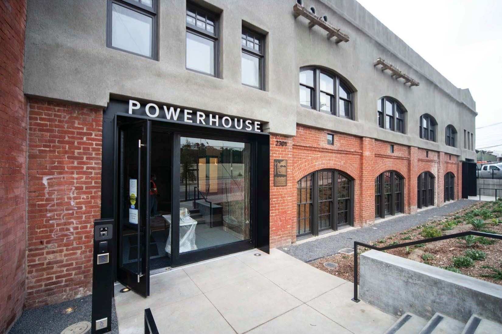 Image shows Geneva Car Barn Front elevation close up of main entrance with Powerhouse in white lette