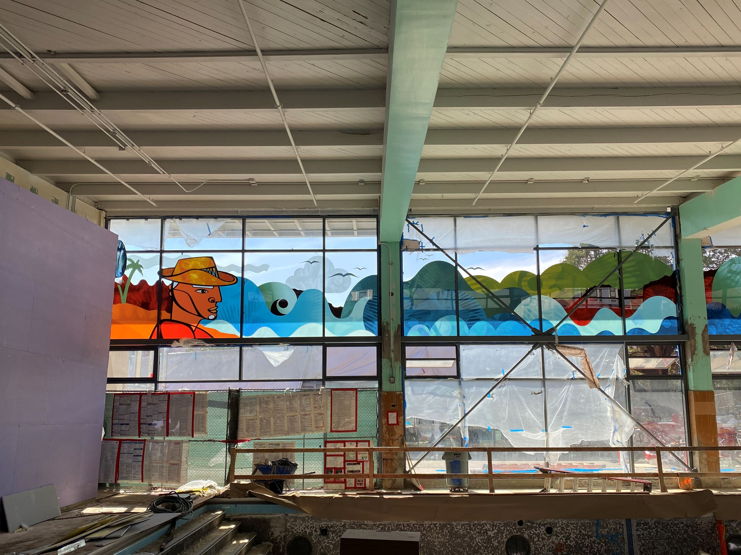 Image is taken from the inside of the Garfiled pool building showing newly installed windows with a