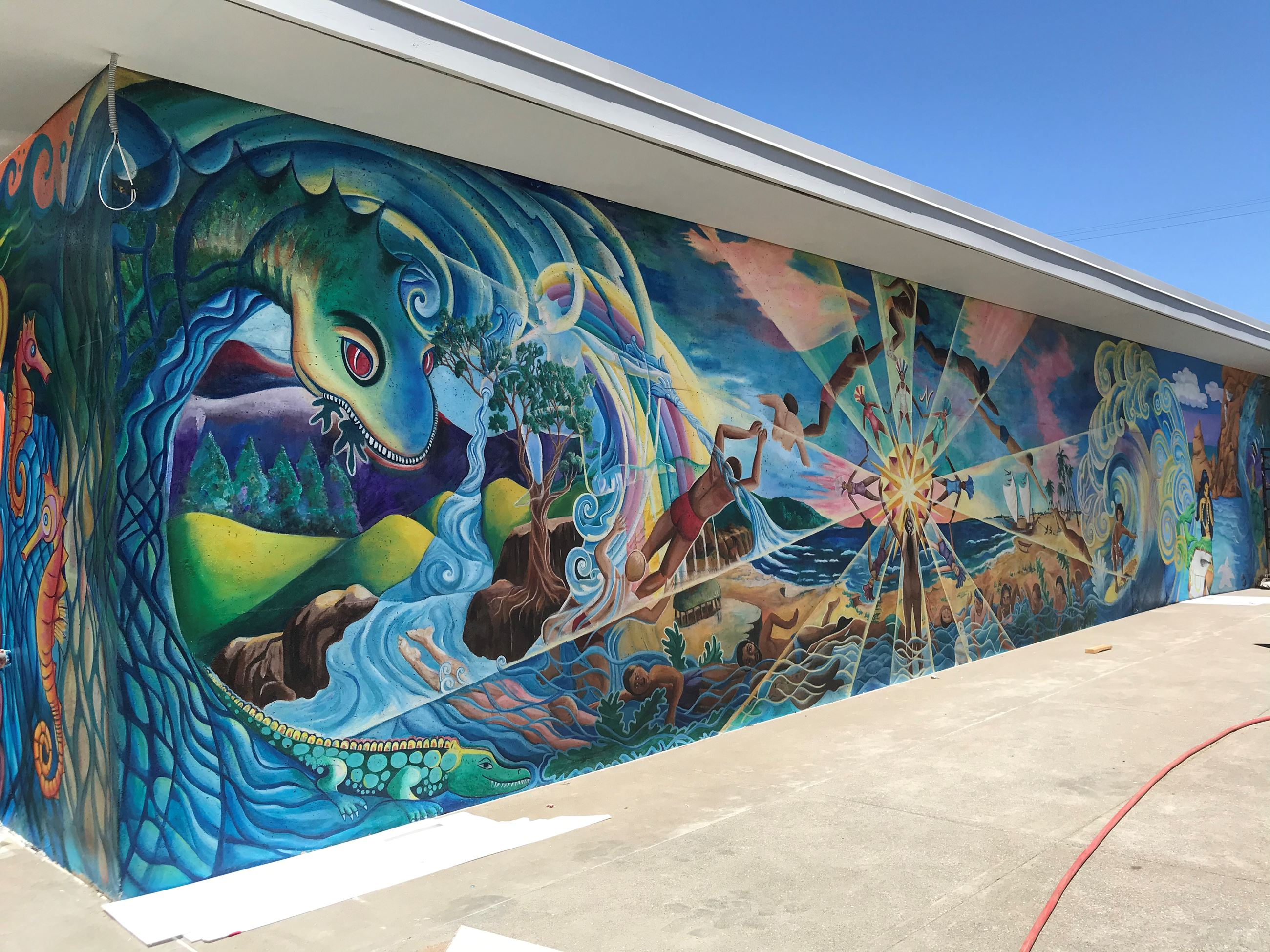 Phot shows the new mural on the Garfield Pool Building. The mural depicts a blue and green dragon ea