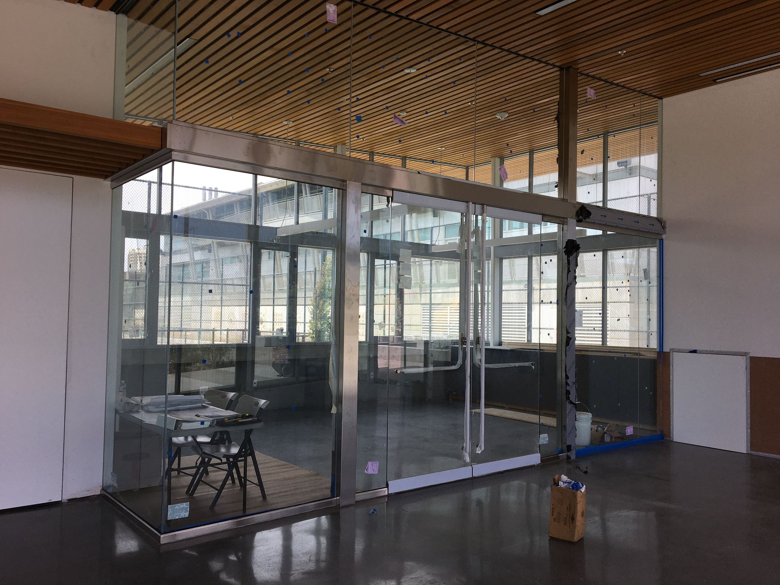 Classroom with glass walls and cement floor inside the clubhouse
