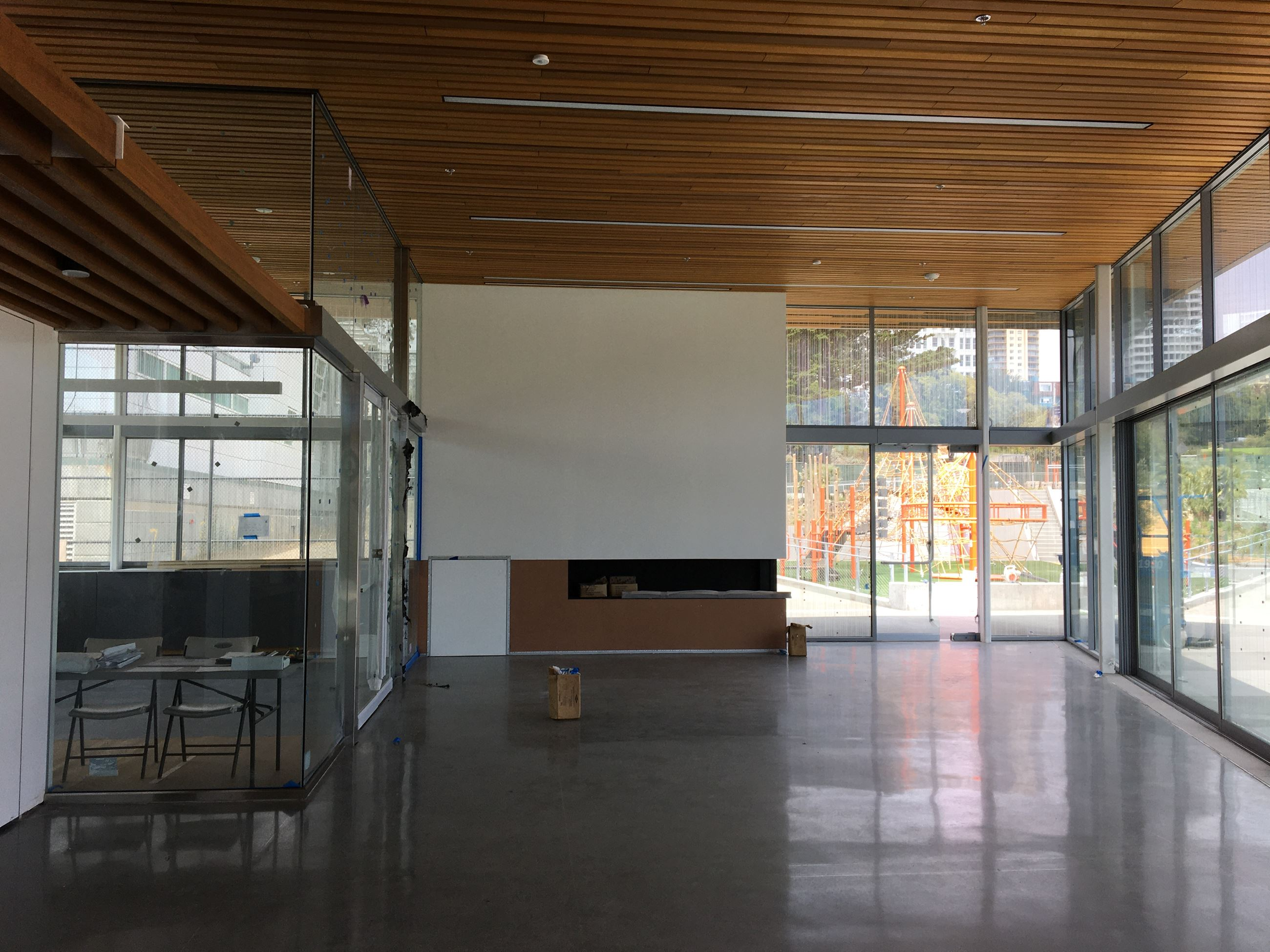 Community room with glass walls inside the new clubhouse