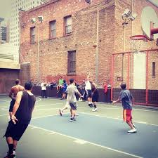 "Men playing basketball at Willie ""Woo Woo"" Wong Playground"