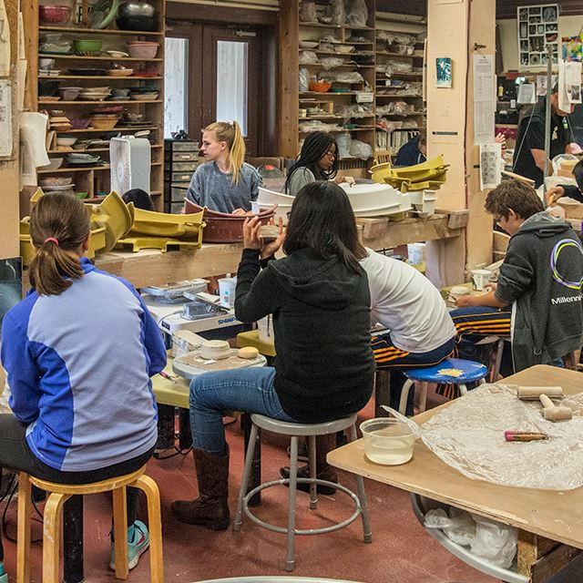 People creating pottery in an art studio